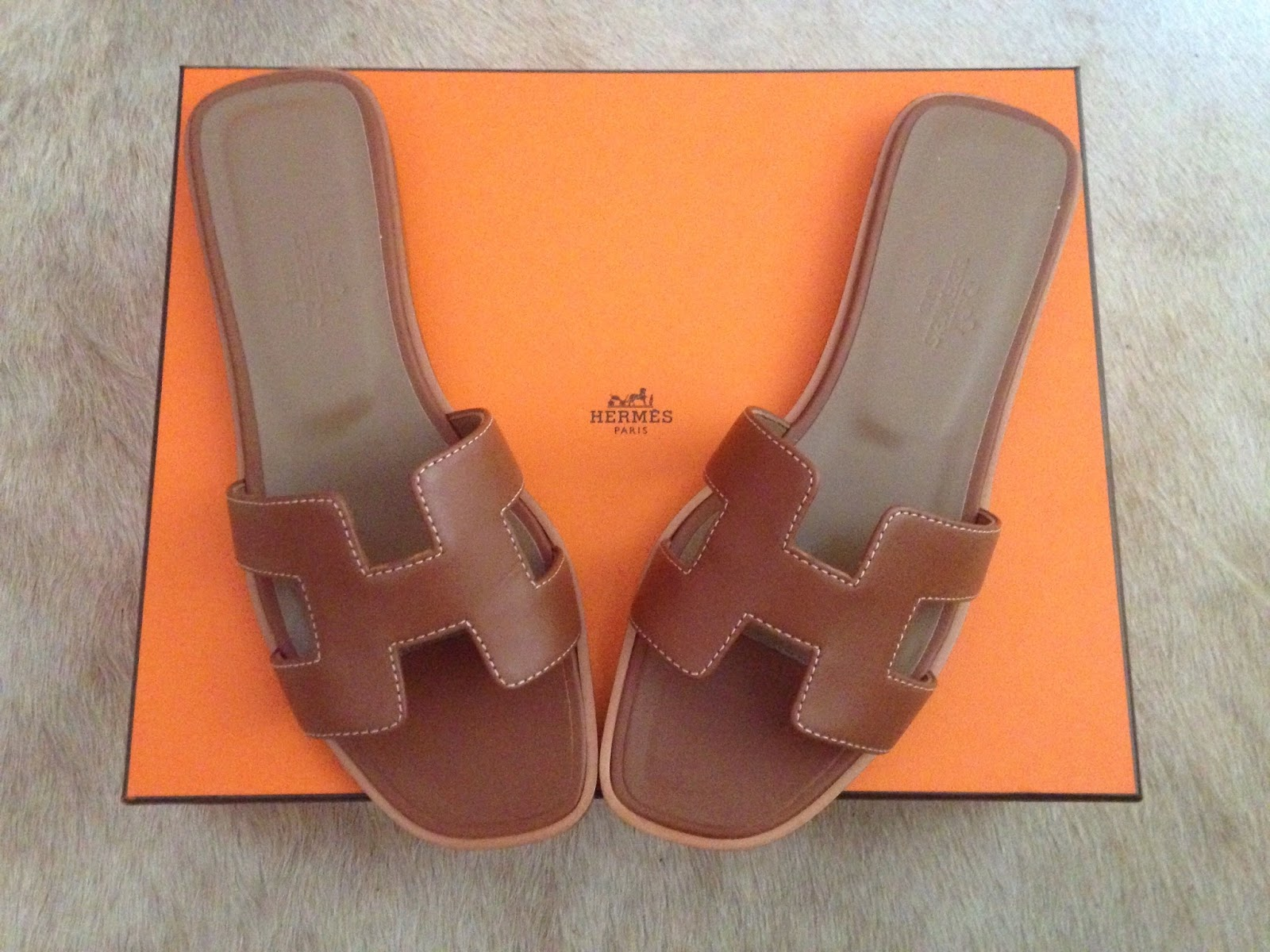 Cristina from The Brunette Nomad, Dallas fashion blogger, shares her first impressions of the Hermes Oran Sandals