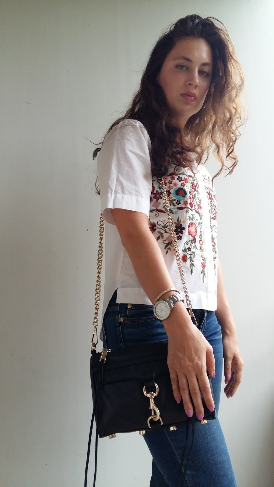Cristina from The Brunette Nomad, Dallas and Swiss based fashion blogger is styling a 70's inspired embroidered top into her modern summer wardrobe
