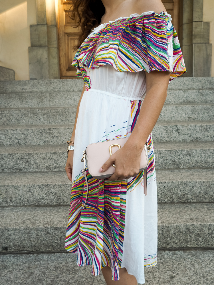 Cristina from The Brunette Nomad, Dallas fashion blogger living in Switzerland, shows you how she wears color by styling an off the shoulder dress with Loeffler Randall heels