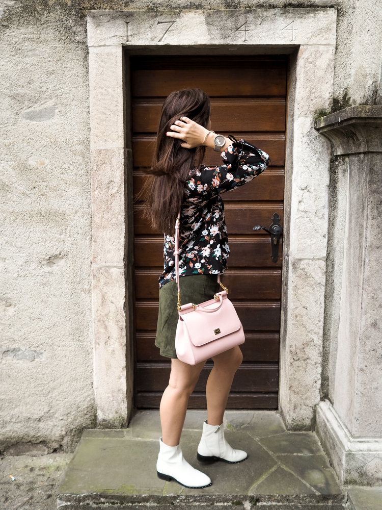 Cristina from The Brunette Nomad, Dallas fashion blogger living in Switzerland, shows how to wear white booties with winter florals
