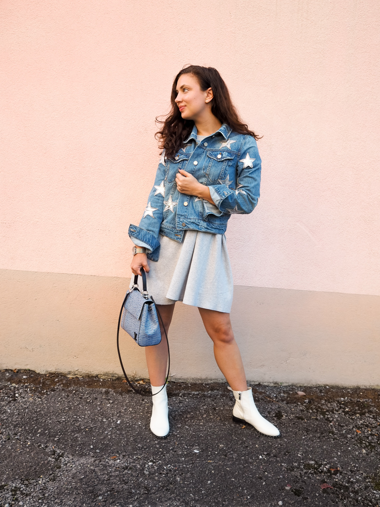 Cristina from The Brunette Nomad, Dallas fashion blogger living in Switzerland, is styling her star printed denim jacket on the blog