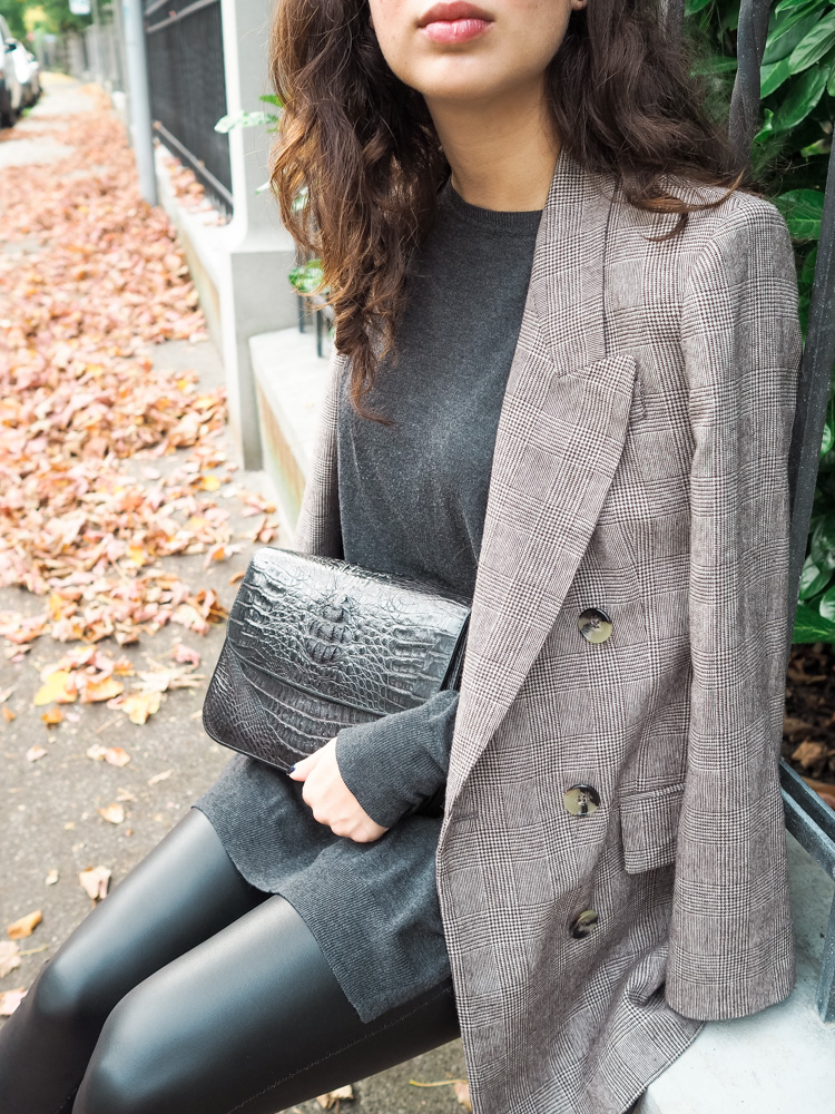 Cristina from The Brunette Nomad, Dallas fashion blogger living in Switzerland, is sharing her favorite leather leggings by Hue