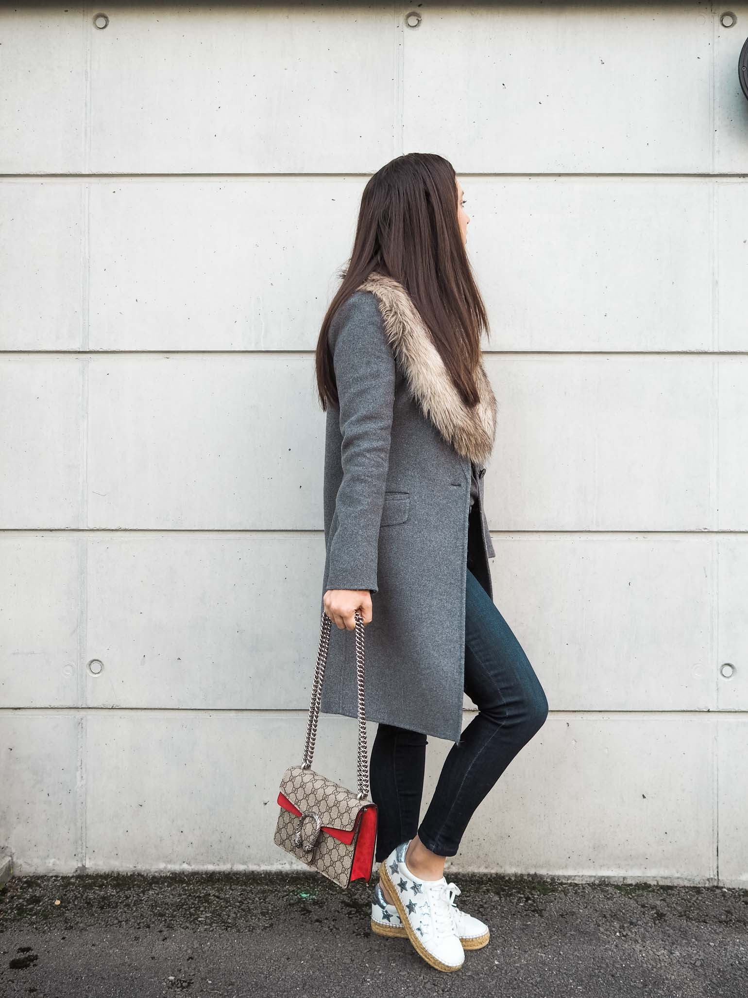 Fashion blogger Cristina of The Brunette Nomad is wearing a casual weekend style with faux fur