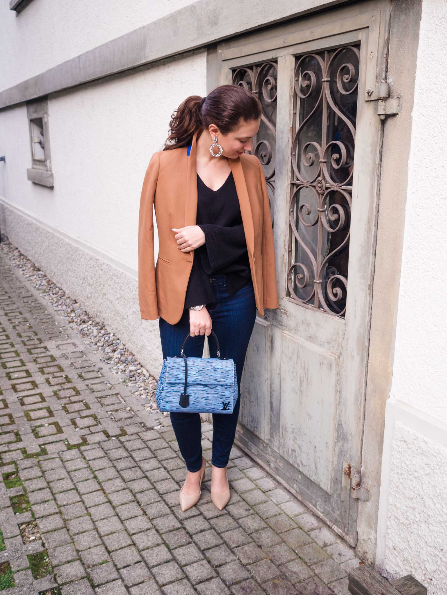 Cristina from The Brunette Nomad, Dallas and Swiss based fashion blogger, shares how to look instantly chic this season with a J.Crew camel blazer