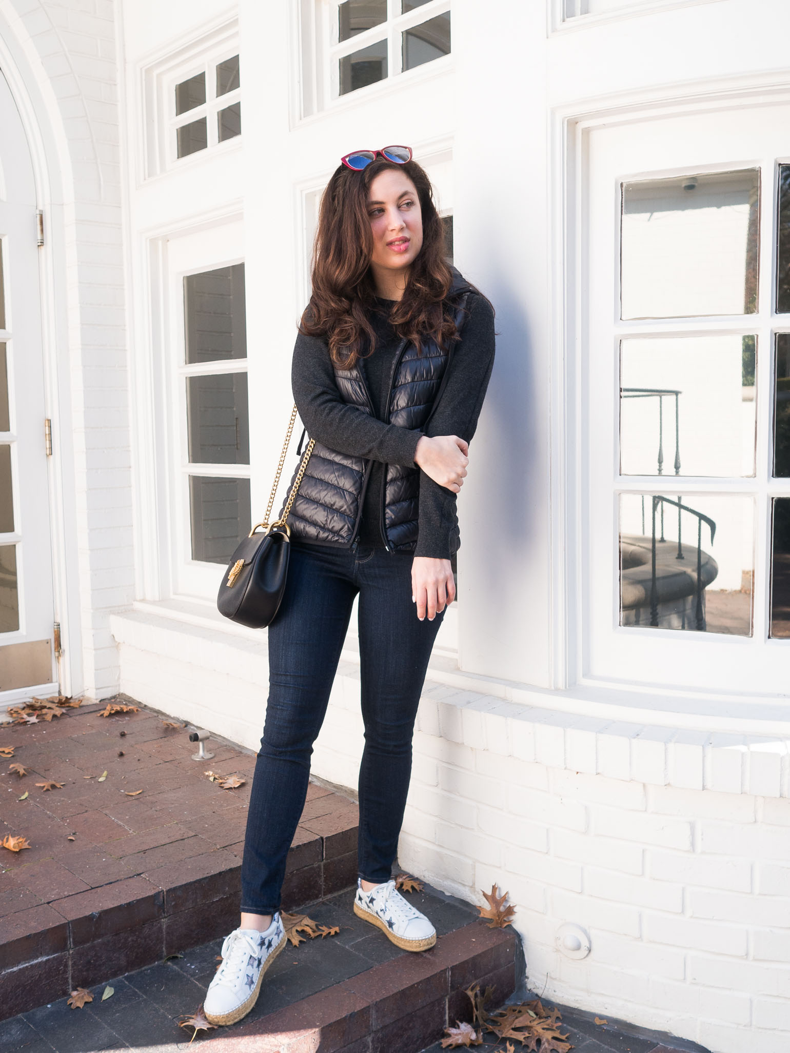 Cristina from The Brunette Nomad, Dallas fashion blogger, shares an athleisure weekend style look on the blog with a puffer vest